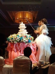 "The wedding couple ""cuts"" the cup-cake at a Thai weddings in Bangkok, 2012"