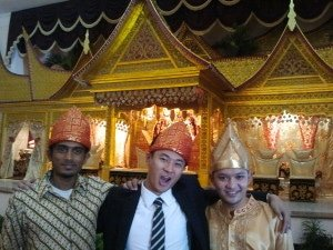 Wearing traditional Padang hats into front of Padang Facade in Bogor, Indonesia
